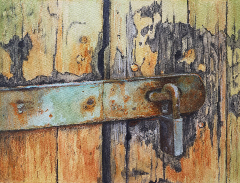 Rusty lock and latch on old paint peeled door.